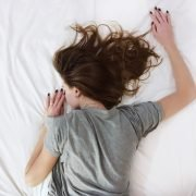woman lying down with painful period